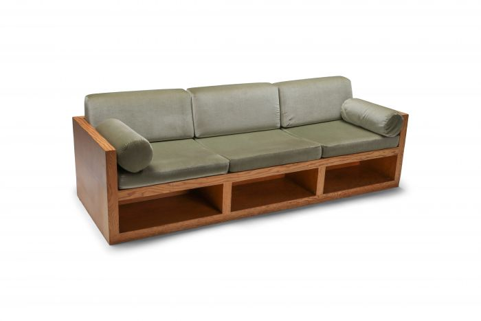 Moss green velvet and pitch pine three-seat sofa - 1960's